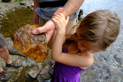A man holds out a piece of rock found in the Clearwater River.