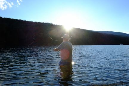 A man casts as he fly fishes the Clearwater River.