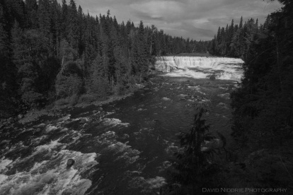 A waterfall is seen in black and white along the Clearwater River.