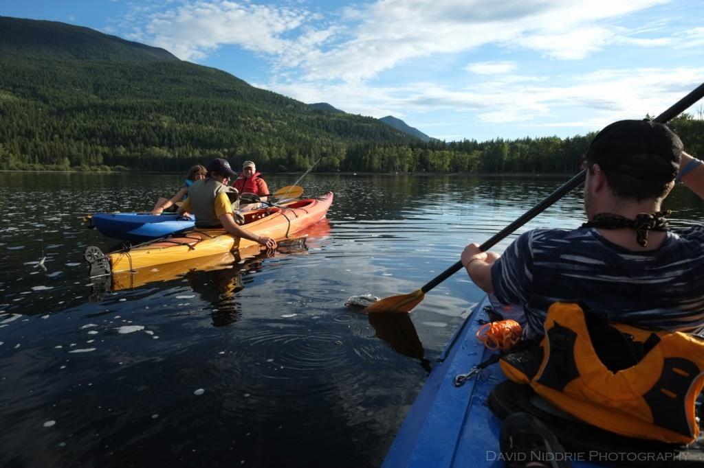 Kayakers meet up on Mahood Lake, BC.