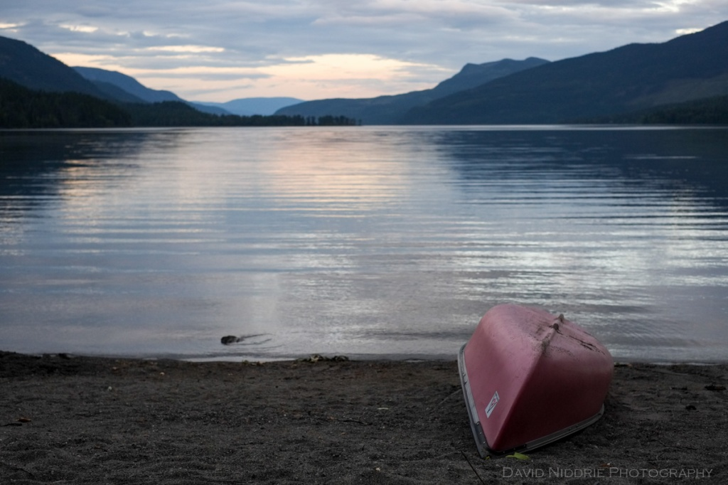 A canoe sits onshore Mahood Lake.