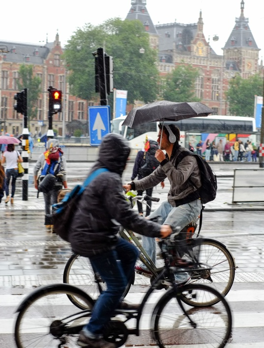 People cycling in the rain in Amsterdam.