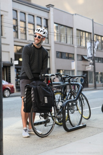 A man poses on a Vancouver street with Two Wheel Gear bicycle pannier.