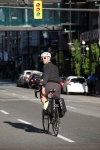 A man rides on a Vancouver street with Two Wheel Gear bicycle pannier.