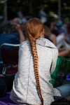 An audience member with a long orange hair braid.