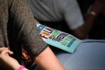 Resting under cover of the Folk Fest program.