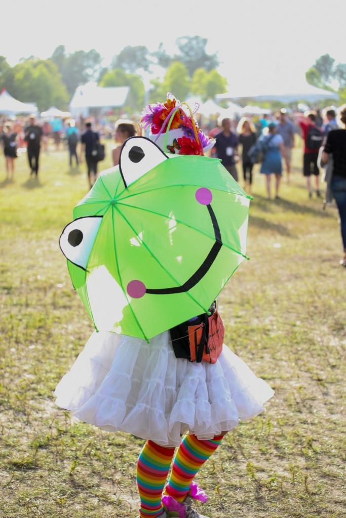 A frog umbrella and a colourful raffle crew member.