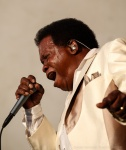 Lee Fields digs deep while performing a song at Vancouver Folk Music Festival.