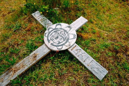 A cross rests at a graveyard in Alert Bay.