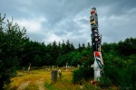Totem poles stand tall at the traditional Namgis Burial Grounds on Alert Bay