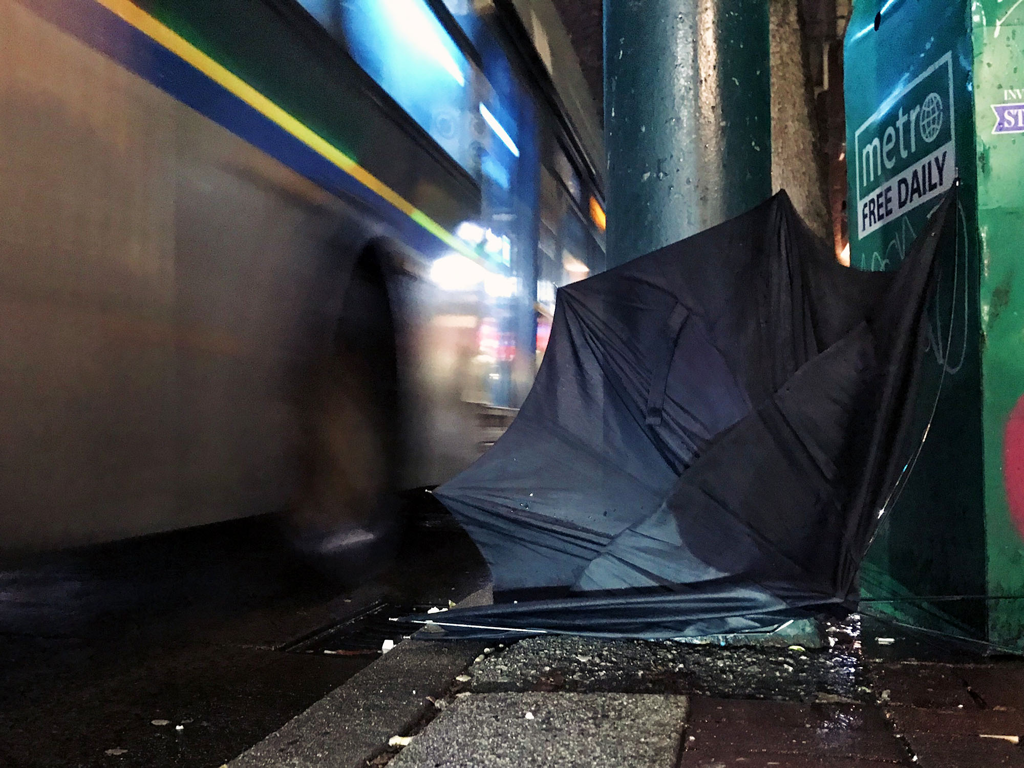 An abandoned umbrella along Hastings Street, Vancouver.